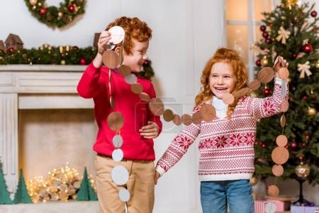 happy kids with festive garland
