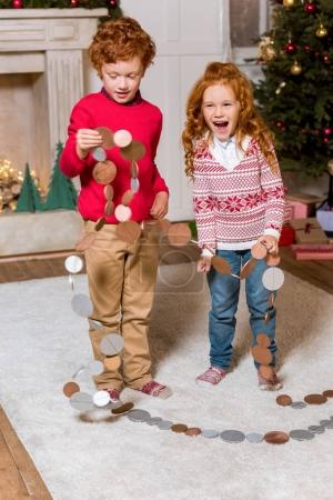 happy kids with festive garland