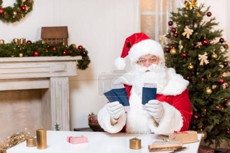 Santa claus with tickets and passports