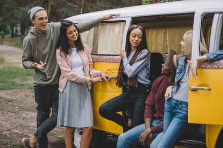 multiethnic friends in retro minivan
