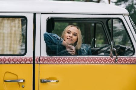 girl sitting in retro minivan