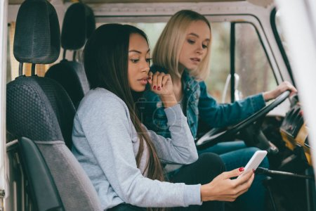 multiethnic girls driving minivan