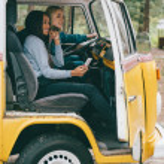 Multiethnic girls in retro minivan