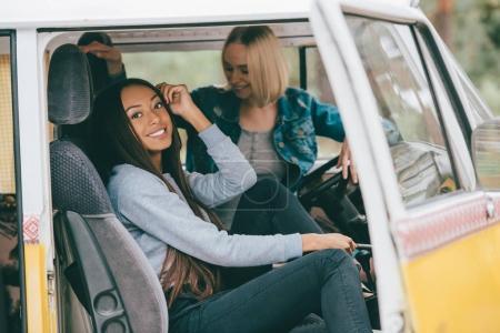 multiethnic girls in minivan