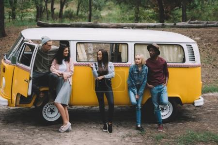 multiethnic friends traveling by minivan