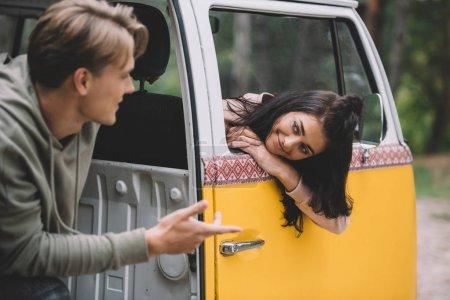 couple talking in minivan