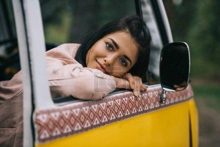 smiling girl in retro minivan