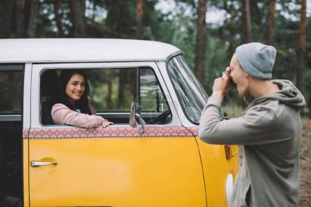 couple taking photo in minivan