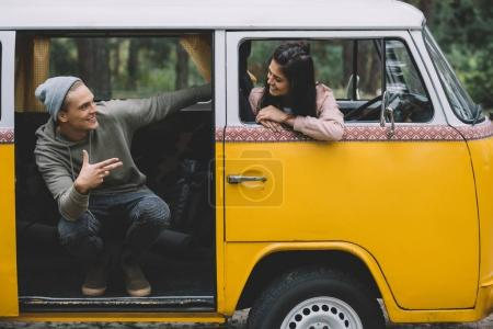 couple in retro styled minivan