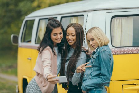 multiethnic girls taking selfie