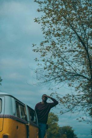 afro man in retro minivan