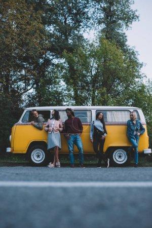 multiethnic friends at minivan