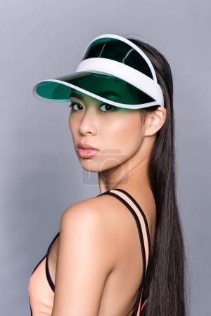 Asian woman in visor