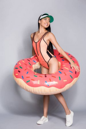 woman in swimsuit wearing pool float