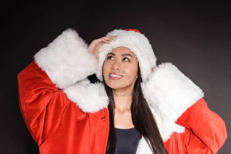 Woman in santa costume and swimsuit