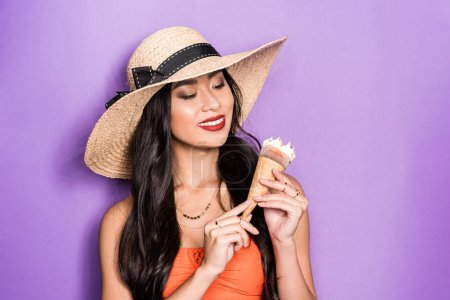 Woman in beach attire holding ice-cream