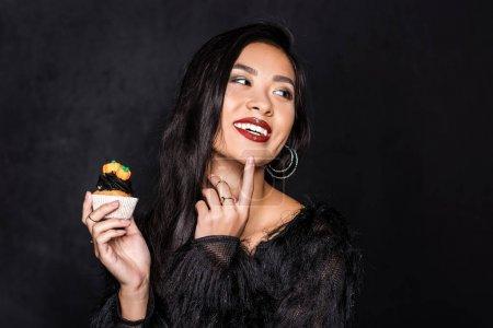 woman holding cupcake