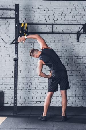 Man stretching before training