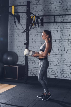 sportive woman with mat