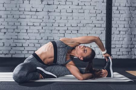 Woman stretching on mat