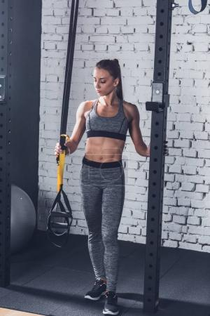 Woman near resistance bands