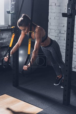 Photo for Athletic woman doing resistance bands Training in gym - Royalty Free Image