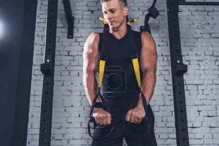 man exercising with resistance bands