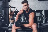 Athletic man with barbell