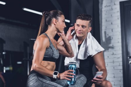 couple listening music in gym