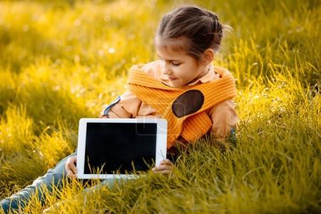 child showing digital tablet