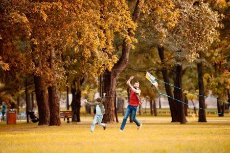Father and son playing with kite