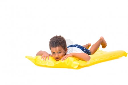 african american boy on swimming mattress