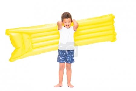 boy holding swimming mattress