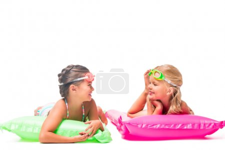 happy kids on swimming mattresses
