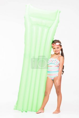Photo for Adorable little girl in swimsuit holding swimming mattress and smiling at camera - Royalty Free Image