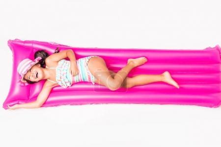 child lying on swimming mattress