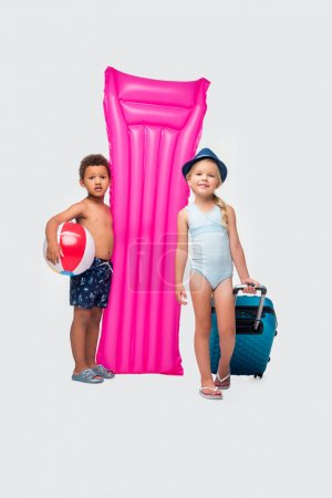 kids with suitcase and swimming mattress
