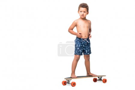 african american kid on longboard