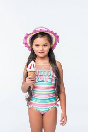 Photo for Beautiful little girl in swimsuit holding ice cream and smiling at camera isolated on white - Royalty Free Image