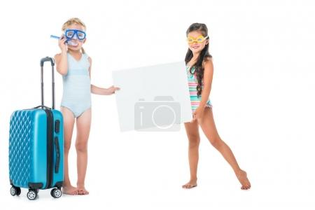 kids with suitcase and blank banner