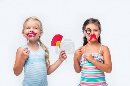 adorable kids with party sticks