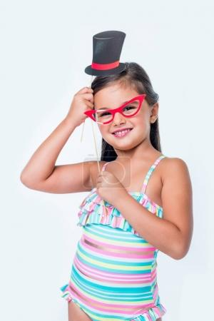adorable child with party sticks