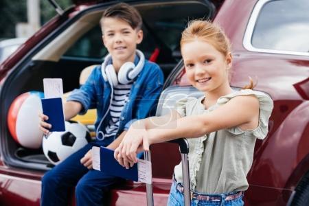 kids with flight tickets