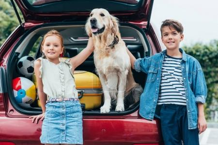 kids with dog in car trunk
