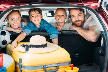 Photo for Family on backseats of car ready for trip - Royalty Free Image