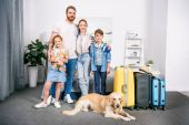 Family with dog ready for trip