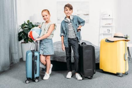 kids with suitcases for trip