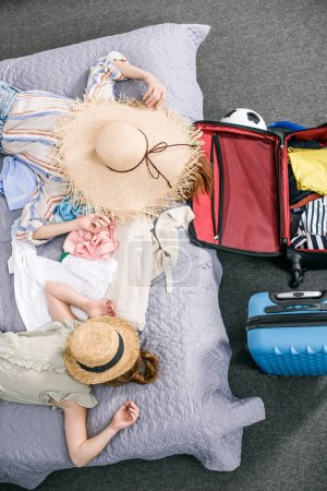 Mother and daughter preparing for trip