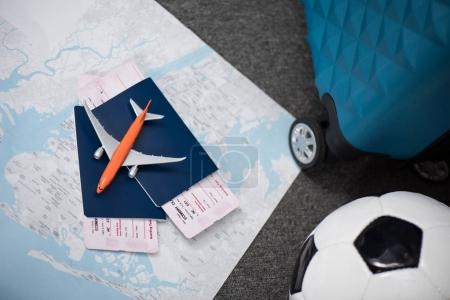 flight tickets with toy airplane