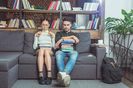 couple with books in library